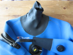 Dry suit - The neck seal, the zip, the inflator, a wrist seal, and the manual cuff vent of a neoprene dry suit