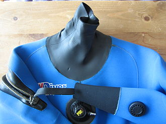 Neoprene - A neck seal, wrist seal, manual vent, inflator, zip and fabric of a neoprene dry suit. Here the soft thin rubber-like seal material at neck and wrists is made from non-foam neoprene for elasticity; the blue area is a thin blue knit fabric laminated onto spongy foamed neoprene for insulation.