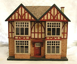 Dollhouse miniature house, possibly for dolls that fit the house according to scale