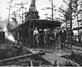 Donkey engine with crew, camp 1, Wynooche Timber Company, probably in Grays Harbor County, ca 1921 (KINSEY 1514).jpeg