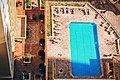 Drone pool and deck chairs (Unsplash).jpg