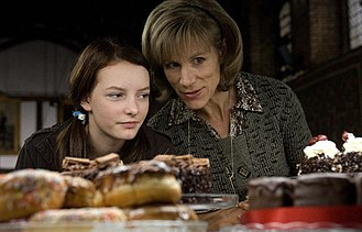 Dustbin Baby (film) - A publicity still from the film showing April (left, played by Dakota Blue Richards) and Marion (played by Juliet Stevenson), in a flashback to when April was still a student at Fairdale.
