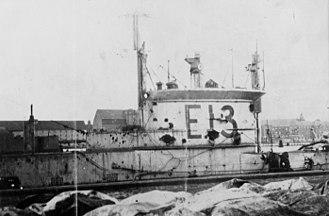 HMS E13 - E13 alongside dock at Copenhagen, showing damage caused by German gunfire