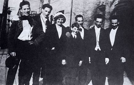 The only known photo of all five Marx brothers with their parents in New York City, 1915; from left: Groucho, Gummo, Minnie (mother), Zeppo, Frenchie (father), Chico, and Harpo Early marx brothers with parents.jpg