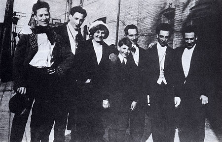 """Groucho, Gummo, Minnie (mother), Zeppo, Frenchy (father), Chico and Harpo, at about the time of their act """"Fun in Hi Skule"""" of 1913."""