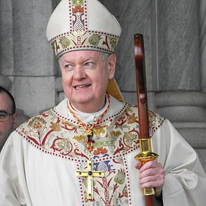 English: Cardinal Edward Egan, appearing outsi...
