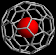 An endohedral fullerene compound containing a noble gas.