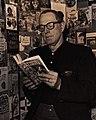 Erskine Caldwell reading a book - 6 January 1964.jpg