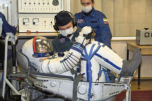 Sokol space suit - Peggy Whitson wearing an inflated Sokol-KV2 spacesuit (2007)