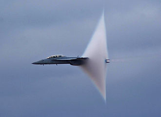 Vapor cone - A F/A-18F during transonic flight