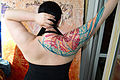 Female back tattoo by Grisha Maslov.jpg