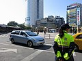 Female police officer in front of TRA Taichung Station 20131203 - panoramio.jpg