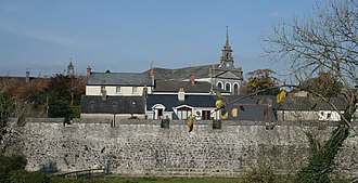 Fethard, County Tipperary - village wall along the northern bank of the Clashawley River.