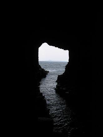 Fingal's Cave - View from the depths of the cave with the island of Iona visible in the background, 2008
