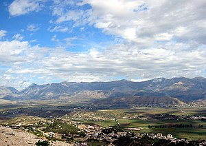 Finiq - The highlands of Delvinë and the hill of Finiq, ancient Phoinike, in the center of the picture behind the plains.