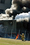 Firefighters work to put out the flames moments after a hijacked jetliner crashed into the Pentagon at approximately 0930 on September 11, 2001 010911-M-CI426-034.jpg
