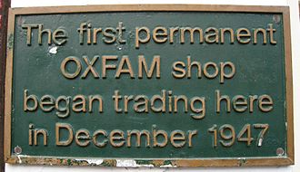 Charity shop - Plaque attached to the original Oxfam shop at 17 Broad Street, Oxford