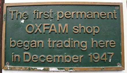 Plaque attached to the original Oxfam shop at 17 Broad Street, Oxford