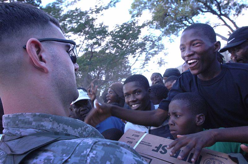 File:Flickr - The U.S. Army - U.S. troops bring food to survivor camp in Haiti.jpg