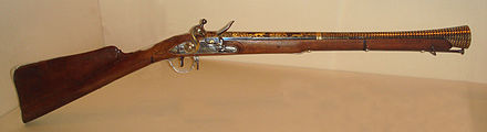 A flintlock blunderbuss, built for Tipu Sultan in Srirangapatna, 1793-94. Tipu Sultan used many Western craftsmen, and this gun reflects the most up-to-date technologies of the time. Flintlock Blunderbuss Tipoo Sahib Seringapatam 1793 1794.jpg