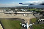 Flying out of Sydney Airport (3430183721).jpg