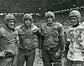 Four of Navy's Mudstained Stars Pose After the Army and Navy Football Game on the Fourth of July at Rizal Stadium, Manila, Philippines - NARA - 45697721.jpg