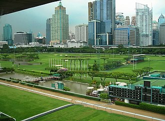 Royal Bangkok Sports Club - View from the grandstand, with Ratchadamri skyscrapers in the background