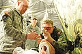 From left to right- U.S. Army Maj. David Masneri, an emergency medicine physician with the 7236th Medical Support Unit, teaches a Canadian soldier how to perform a tracheal intubation on a training mannequin 130221-A-DB144-585.jpg