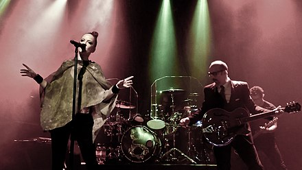 Garbage in concert May 2012, with Erikson on the right GarbageLiveMay2012.jpg