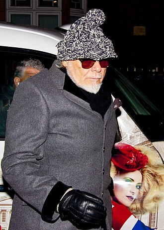 Glitter in 2012 Gary Glitter arrives home after spending the day being questioned by detectives (12888246573).jpg