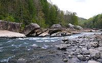 Light rapids of a river between rocky riverbanks