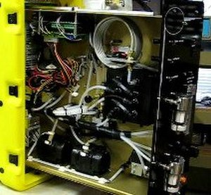 Gas chromatography - This image above shows the interior of a GeoStrata Technologies Eclipse Gas Chromatograph that runs continuously in three-minute cycles. Two valves are used to switch the test gas into the sample loop. After filling the sample loop with test gas, the valves are switched again applying carrier gas pressure to the sample loop and forcing the sample through the column for separation.