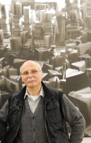Gia Bugadze - Gia Bugadze in  front of his artwork. Tbilisi State Academy of Arts. Dec. 2010