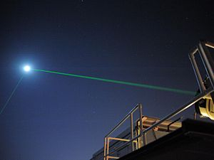 Lunar Reconnaissance Orbiter - In this image, the lower of the two green beams is from the Lunar Reconnaissance Orbiter's dedicated tracker.