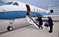 Great Lakes Special Envoy Feingold Boards the Plane.jpg