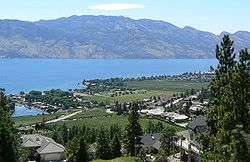 West Kelowna as seen from Mount Boucherie, with Okanagan Lake and Okanagan Mountain Provincial Park in the background