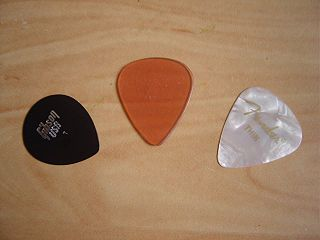 Plectrum small flat tool used to pluck or strum a stringed instrument