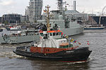 HMCS Iroquois (DDG 280) at Port of Hamburg with tugship.jpg