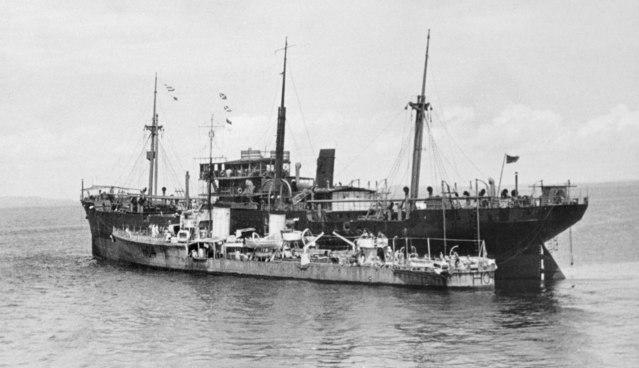HMS TENEDOS (H04) ALONGSIDE SS NORAH MOLLAR 3 FEB 1942