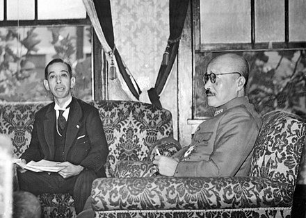 "Hideki Tojo (right) and Nobusuke Kishi, the key architect of Manchukuo (1935-39), also known as the ""Showa (Emperor) era monster/devil"" Hideki Tojo and Nobusuke Kishi in 1943.jpg"