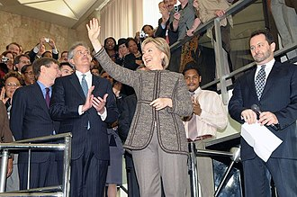 Foreign policy of the Barack Obama administration - Secretary of State Hillary Clinton arrives at the State Department on her first day greeted by a standing room only crowd of Department employees.