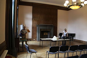 Führerbau - Room where the 1938 Munich Agreement was signed. Note the original fireplace and overhead lamp.