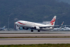 Hong Kong Airlines B-KBE taking off at Hong Kong International Airport.jpg