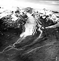 Hook Glacier, terminus of mountain glacier, partially covered in bands of rock and other debris, icefall along upper portions of (GLACIERS 6652).jpg