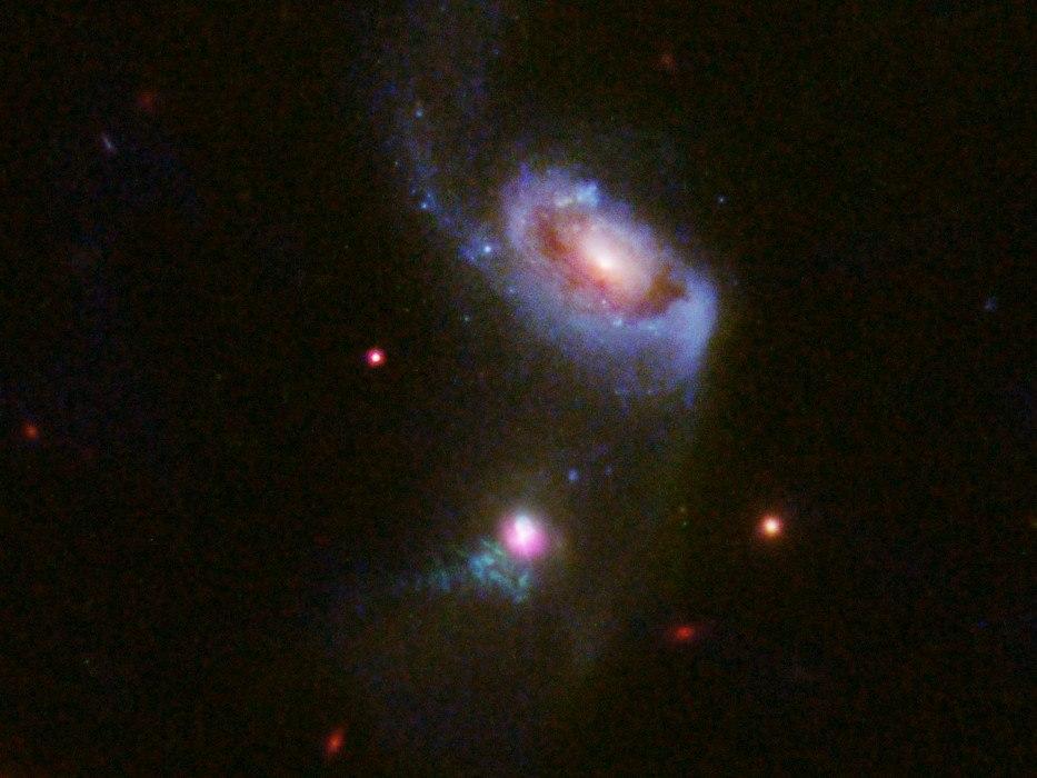 Hubble views a supermassive black hole burping — twice
