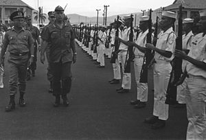 Republic of Vietnam Navy - Commodore Tran Van Chon, Chief of Naval Operations, (left) and Admiral Thomas H. Moorer, U.S. Navy Chief of Naval Operations, (left center) inspect some of the South Vietnamese sailors who will take over river patrol operations from the U.S. Navy, c. September 1969. Note the M1 Garand rifles held by the sailors.