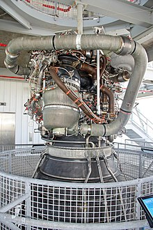 The SSME is a compact tangle of pipework attached to a much larger rocket nozzle.