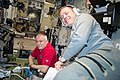 ISS-52 Fyodor Yurchikhin and Jack Fischer working inside the Zvezda service module.jpg