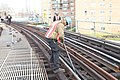 Installing plates and rails on F line (11294190923).jpg