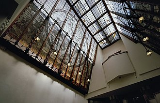 Scheepvaarthuis -  Enclosed stained-glass ceiling above the main staircase showing typical nautical themes.